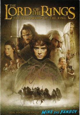 lord of the rings signed autograph elijah wood frodo dvd cover photo elijah wood signing autographs for fans the hobbit lord of the rings star signed autograph at henry's tacos in studio city ca