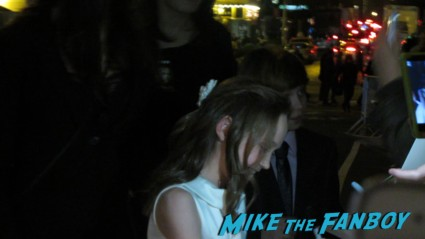 Isabelle Allen and Daniel Huttlestone signing autographs for fans at the les miserables movie premiere in new york city signed autograph rare