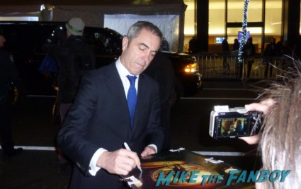 James Nesbitt signing autographs for fans at the hobbit world movie premiere in new york city