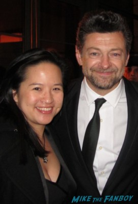 Andy Serkis posing for a fan photo at the hobbit world movie premiere after party in new york city