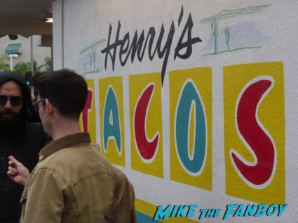 Henry's tacos in studio city CA rare aaron paul signing autographs for fans elijah wood lord of the rings star rare promo
