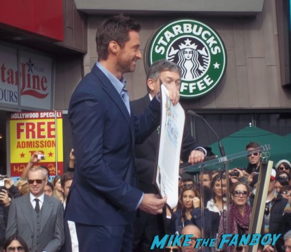 Hugh Jackman's walk of fame star ceremony in hollywood jay leno at hugh jackman's walk of fame star ceremony signing autographs for fans