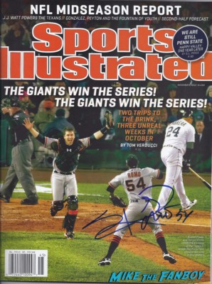 Sergio Romo signed autograph sports illustrated magazine rare and E40 signing autographs and taking fan photos tor toys for tots in the san francisco bay area rare promo signed autographs