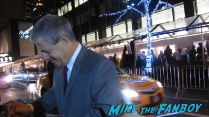 Sir Cameron Mackintosh signing autographs for fans at the les miserables premiere in new york city rare promo signed