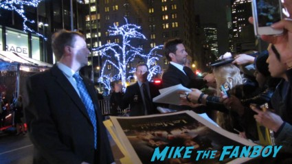 hugh jackman signing autographs for fans at the les miserables movie premiere in new york city rare