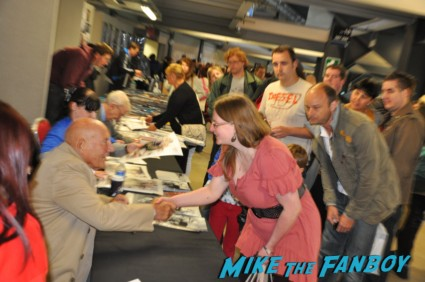 Sir Stirling Moss signing autographs for fans at collectormania in london rare formula 1 race car driver