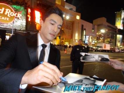 sexy daniel henney signed autograph photo rare photo shoot gene simmons signing autographs for fans at the last stand movie premiere red carpet Arnold Schwarzenegger jamie alexander rare promo red carpet photo