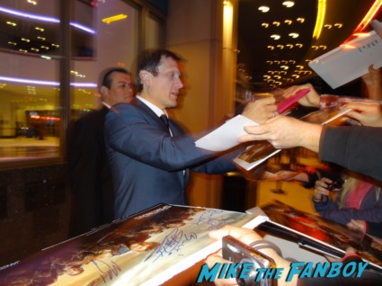 Dan Feuerriegel signing autogaphs at the Spartacus: War of the Damned television premiere starz cast rare red carpet liam mcintyre lucy lawless