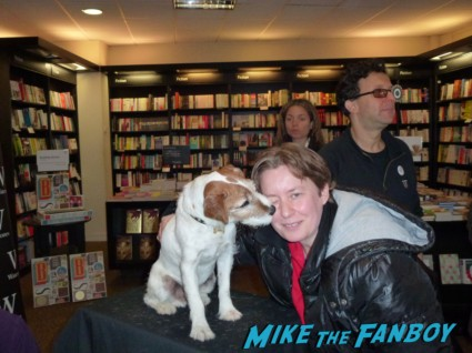 lady samantha from mike the fanboy posing with uggie the dog from the artist at his book signing uggie paw print signing and book autograph signing the artist dog paw print waterstones london