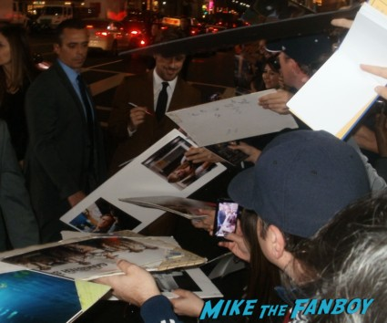 sexy ryan gosling signing autographs at the Gangster Squad Movie Premiere red carpet marquee with sean penn ryan gosling emma stone josh brolin