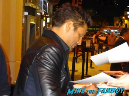 Manu Bennett signing autogaphs at the Spartacus: War of the Damned television premiere starz cast rare red carpet liam mcintyre lucy lawless