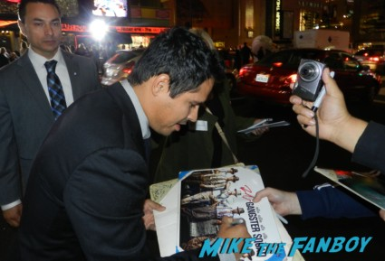 sexy Michael Peña signing autographs at the Gangster Squad Movie Premiere red carpet marquee with sean penn ryan gosling emma stone josh brolin