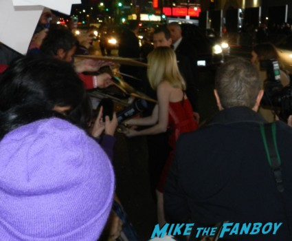 sexy emma stone signing autographs at the Gangster Squad Movie Premiere red carpet marquee with sean penn ryan gosling emma stone josh brolin
