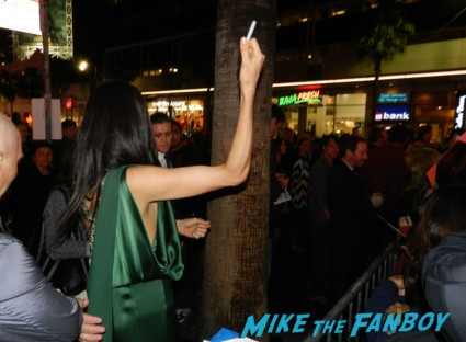 Famke Janssen signing autographs at the Hansel & Gretel: Witch Hunters World Movie Premiere getting dissed by Jeremy Renner and Gemma Arterton rare