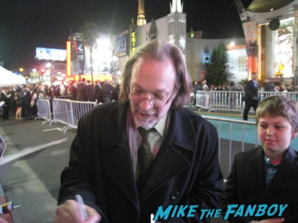 greg nicoterro signing autographs for fans Oz the great and powerful movie premiere red carpet with james franco mila kunis michelle williams