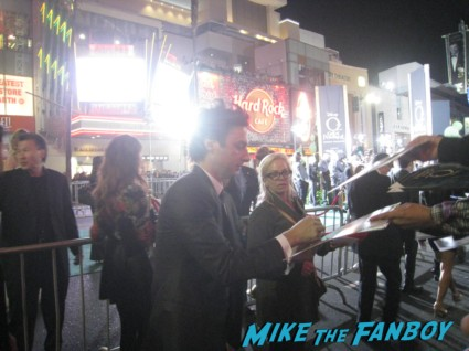 zach braff signing autographs for fans Oz the great and powerful movie premiere red carpet with james franco mila kunis michelle williams