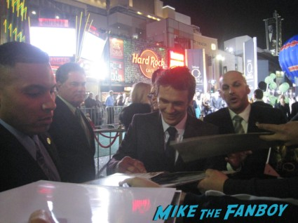 sexy james franco signing autographs for fans Oz the great and powerful movie premiere red carpet with james franco mila kunis michelle williams