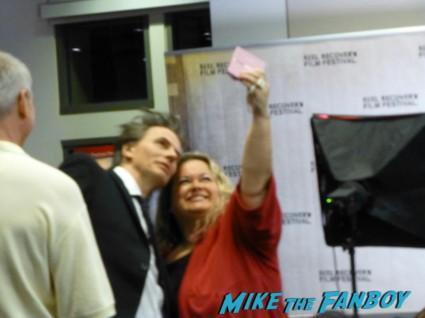 john taylor taking a fan photo at his reception at the skirball center rare promo