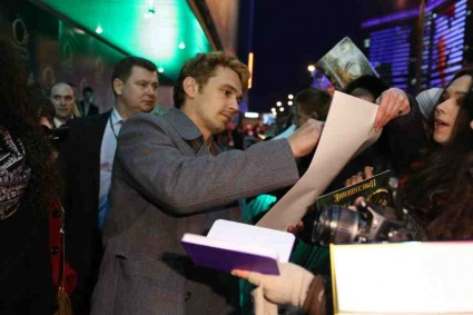 James Franco signing autographs for fans michelle williams mila kunis and Sam Raimi oz the great and powerful movie premiere red carpet moscow russia photo