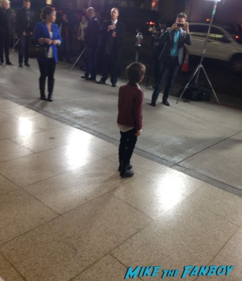 a little boy signing autographs for fans the dark skies movie premiere at the arclight cinerama dome signing autographs