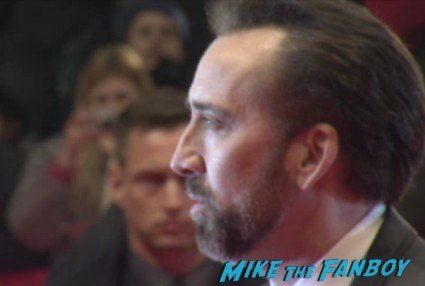 nicholas cage at the croods berlin film festival world movie premiere with emma stone nicholas cage signing autographs rare promo red carpet photo