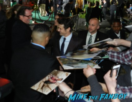 sexy james franco signing autographs at the OZ The Great And Powerful Movie Premiere red carpet hot air balloon rare james franco rare promo el capitan theater los angeles oz great and powerful movie premiere 002