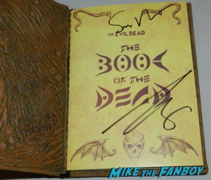 sam Rami bruce campbell signed autograph evil dead dvd signing autographs at the OZ The Great And Powerful Movie Premiere red carpet hot air balloon rare james franco rare promo el capitan theater los angeles oz great and powerful movie premiere 002