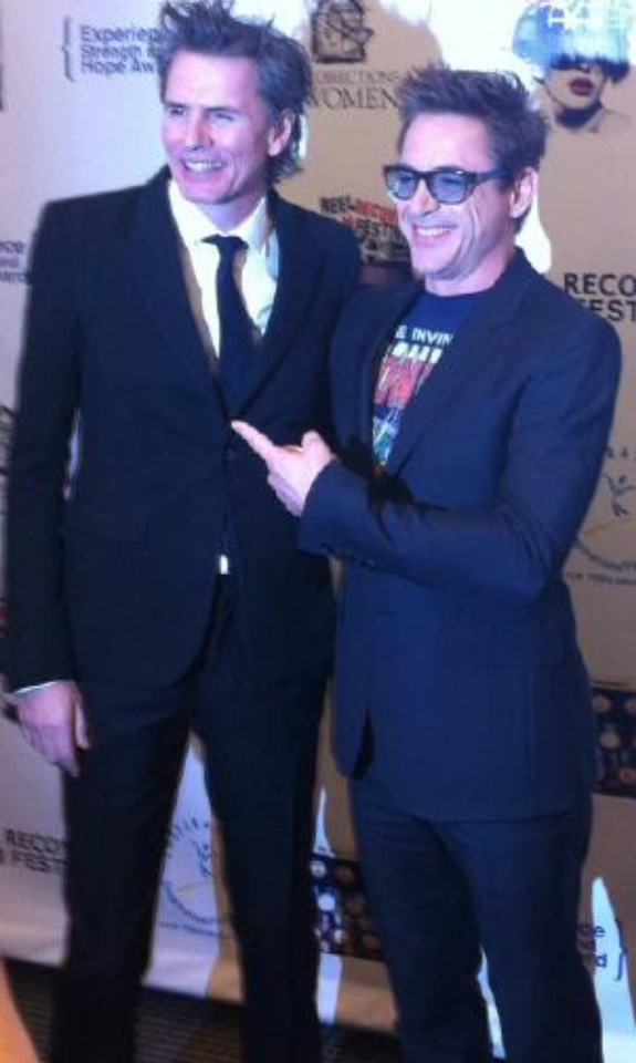 robert downey jr. with john taylor taking photos on the red carpet rare promo