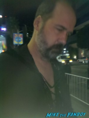 Krist Novoselic  signing autographs for fans at the sound city movie premiere red carpet foo fighters signing autographs (3)