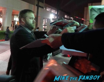 Robert Kirkman signing autographs for fans at an evening with the walking dead at the television academy on lankershim