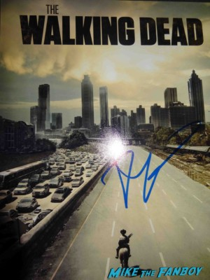 Robert kirkman signed autograph the walking dead season 1 promo poster rare hot promo Robert Kirkman signing autographs for fans at an evening with the walking dead at the television academy on lankershim