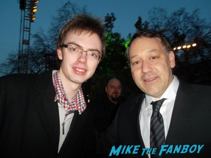 sam raimi signing autographs for fans at the oz the great and powerful london movie premiere