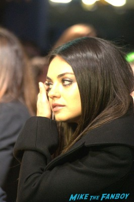 Mila Kunis signed autograph signing autographs for fans at the oz the great and powerful london movie premiere