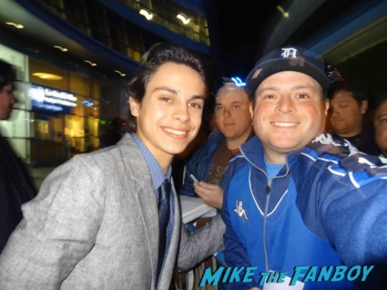 jake T Austin signing autographs for fans at the premiere of the call in hollywood