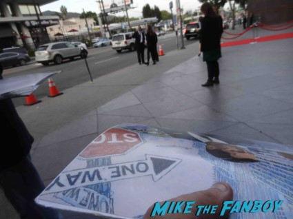Robert Morse signing autographs at the mad men season 6 premiere in hollywood