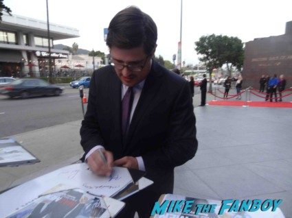 rich sommer signing autographs at the mad men season 6 premiere in hollywood
