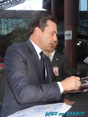 Jon Hamm signing autographs at the mad men season 6 premiere in hollywood