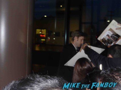 aaron stanton signing autographs at the mad men season 6 premiere in hollywood