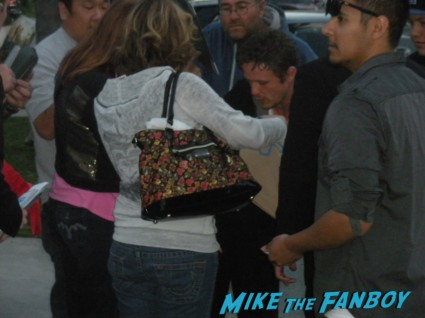 david lyons from revolution signing autographs for fans after the panel signature autograph