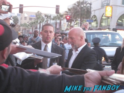 "Bruce Willis signing autographs for fans G.I. Joe: Retaliation Movie Premiere Photo Gallery! A Miracle Happened! Bruce Willis Picked Up A Sharpie! Say Wha!?! With Dwayne ""The Rock"" Johnson! Byung-hun Lee! Luke Bracey! Autographs! Photos! And More! G.I. Joe_March 2013 001"