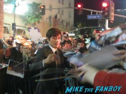 "Byung-hun Lee signing autographs for fans G.I. Joe: Retaliation Movie Premiere Photo Gallery! A Miracle Happened! Bruce Willis Picked Up A Sharpie! Say Wha!?! With Dwayne ""The Rock"" Johnson! Byung-hun Lee! Luke Bracey! Autographs! Photos! And More! G.I. Joe_March 2013 001"