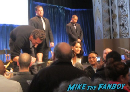 the cast of the newsroom signing autographs for fans at Dev Patel, Olivia Munn, Thomas Sadoski, Alison Pill, John Gallagher Jr., Sam Waterston, Emily Mortimer, Jeff Daniels (who does a curtsey), Alan Poul and Aaron Sorkin the newsroom 2013 paleyfest panel q and a rare