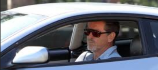 Pierce Brosnan in his car signing autographs for waiting fans rare promo shocked face hot sexy 007 star rare remington steele