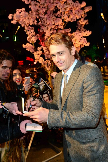 James Franco signing autographs for fans at the oz the great and powerful movie premiere in London UK