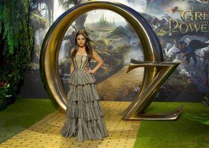 mila kunis signing autographs for fans at the oz the great and powerful movie premiere in London UK