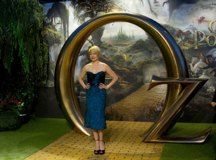 michelle williams signing autographs for fans at the oz the great and powerful movie premiere in London UK