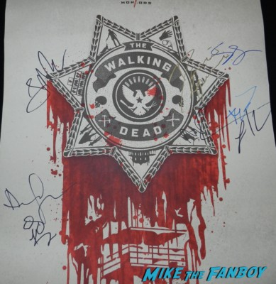the walking dead paleyfest 2013 limited edition promo poster signed autograph andrew lincoln laurie holden steven yuen norman reedus the walking dead season 3 signed autograph promo mini poster norman reedus andrew lincoln laurie holden steven yuen danai gurira signed autograph entertainment weekly magazine  signing autographs at the walking dead paleyfest 2013 panel signing autographs norman 058 panel signing autographs norman 177