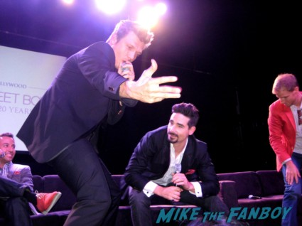 nick carter from the backstreet boys signing autographs at the backstreet boys 20th anniversary celebration in los angeles