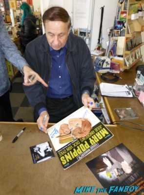Richard M. Sherman signing autographs for fans and playing music at an instore signing