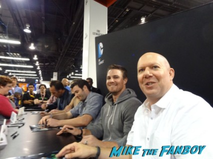 stephen amell and Marc Guggenheim signing autographs at the arrow signing at wondercon 2013 rare promo hot sexy signed poster rare